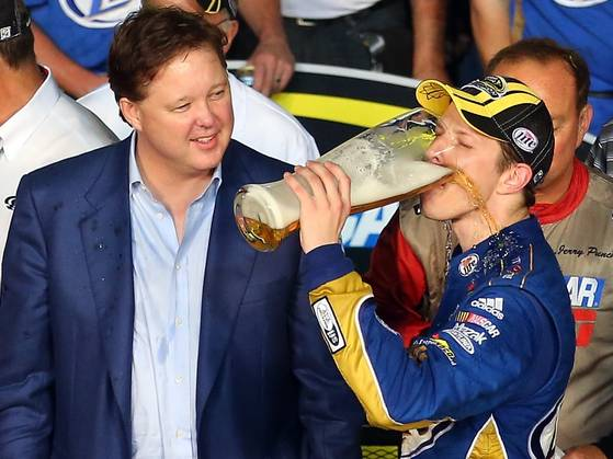 Brad Keselowski celebrates the 2012 Sprint Cup Series championship with a tall Miller Lite. Photo: Todd Warshaw, Getty Images