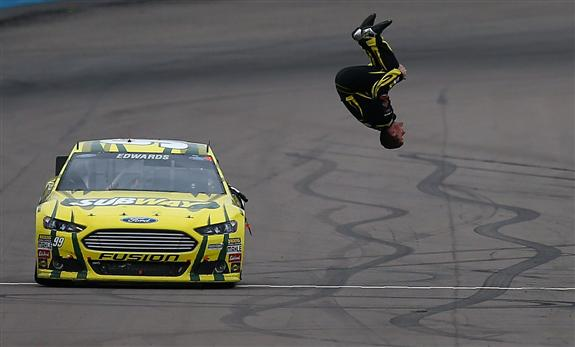 Jerry Markland/Getty Images Carl Edwards, driver of the #99 Subway Ford, performs a back flip to celebrate after winning the NASCAR Sprint Cup Series Subway Fresh Fit 500 at Phoenix International Raceway on March 3, 2013 in Avondale, Arizona.