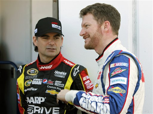 Jeff Gordon, left, and Dale Earnhardt Jr., talk outside the garage during practice for the NASCAR Daytona 500 Sprint Cup Series auto race at Daytona International Speedway, Wednesday, Feb. 20, 2013, in Daytona Beach, Fla. (AP Photo/Terry Renna)