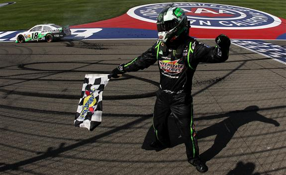 Kyle Busch, driver of the #18 Interstate Batteries Toyota, celebrates after winning the NASCAR Sprint Cup Series Auto Club 400 at Auto Club Speedway on March 24, 2013 in Fontana, California. (Photo by Todd Warshaw/NASCAR via Getty Images)