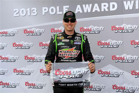 Credit: 284803John Harrelson/NASCAR via Getty Images Kyle Busch, driver of the #18 Interstate Batteries Toyota, poses with the Coors Light Pole Award after qualifying for the NASCAR Sprint Cup Series NRA 500 at Texas Motor Speedway on April 12, 2013 in Fort Worth, Texas.